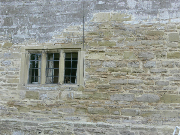 Masonry repairs to stone wall