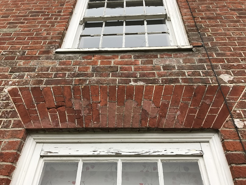 Rubbed brick arch in poor condition