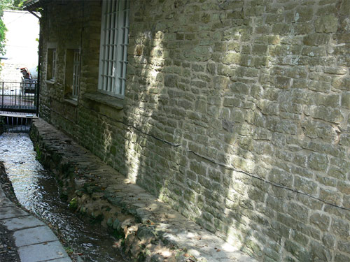 Repaired stone wall